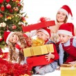 Family with kids open Christmas gift box. — Stock Photo