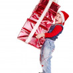 Kid with Christmas gift box. — Stock Photo #7893382