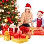 Family with child near Christmas tree. — Stock Photo #7893390