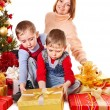 Stock Photo: Family with Christmas gift box.