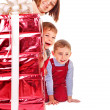 Family with kid giving Christmas gift box. — Stock Photo #7893398