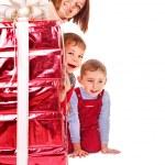 Family with kid giving Christmas gift box. — Stock Photo #7893398