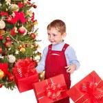 Kid with Christmas gift box. — Stock Photo #7893410