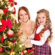 Family decorate Christmas tree. — Stock Photo