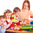 Kindergarden teacher with children. — Stock Photo #7893428