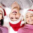 Girls in santa hat lying head next to head. — Stock Photo #7893512
