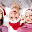 Girls in santa hat lying head next to head. — Foto de Stock   #7893512