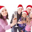Group young in santa hat. Isolated. — Stock Photo #7893518