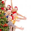 Group young by christmas tree. — Stock Photo #7893522