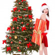 Christmas girl in santa holding gift box. — Stock Photo #7893547