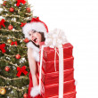 Christmas girl in santa holding stack gift box. - Стоковая фотография