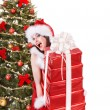 Christmas girl in santa holding stack gift box. — Stock Photo #7893549