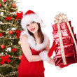 Christmas girl in santa holding stack gift box. — Stock Photo #7893550