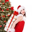 Christmas girl in santa hat holding stack  gift box. - Стоковая фотография