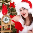 Christmas girl in santa hat holding stack  gift box. - Stock Photo