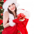 Girl in santa holding christmas socks and gift box. - Стоковая фотография