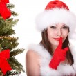 Christmas girl in santa hat with fir tree. - Stock Photo
