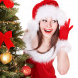 Girl in santa hat listen near christmas tree. — Stock Photo #7893576