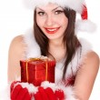 Girl in Santa hat giving Christmas box. — Stock Photo #7893577