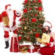 Christmas girl, santa clause and fir tree. - Stock Photo