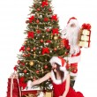 Christmas girl, santa clause and fir tree with gift box group. — Stock Photo