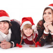 Royalty-Free Stock Photo: Happy family with child in santa hat.