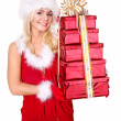 Royalty-Free Stock Photo: Christmas girl in santa hat holding stack gift box.
