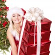 Girl stack gift box by christmas tree.. — Stock Photo #7894147