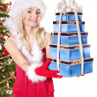 Girl stack  gift box by christmas tree.. - Стоковая фотография