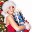 Girl in Santa hat holding stack gift box. — Stock Photo