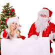 Santa claus and christmas girl holding banner. — Stock Photo
