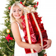 Girl stack gift box by christmas tree.. — Stock Photo #7894185