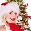 Christmas girl in Santa hat and cake. — Stock Photo