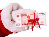 Santa Claus hand with money (Russian rouble). — Stock Photo