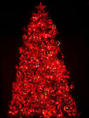 Christmas tree with light and red ball. — Stock Photo