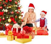Family with child near Christmas tree. — Stock Photo