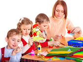 Kindergarden teacher with children. — Stock Photo