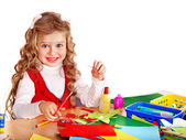 Kid with scissors and glue. — Stock Photo