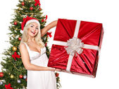 Girl stack gift box by christmas tree.. — Stock Photo