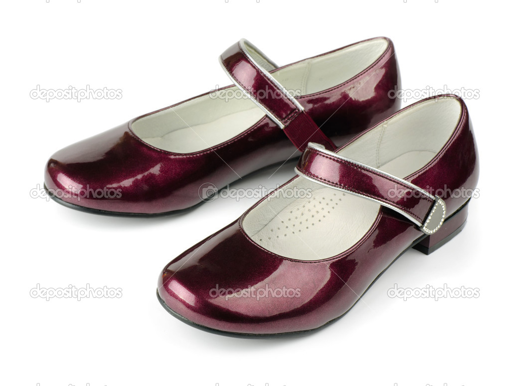 Red girls patent leather shoes isolated on white — Stock Photo #6789687