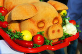 Toy pig and decorative vegetables — Stockfoto