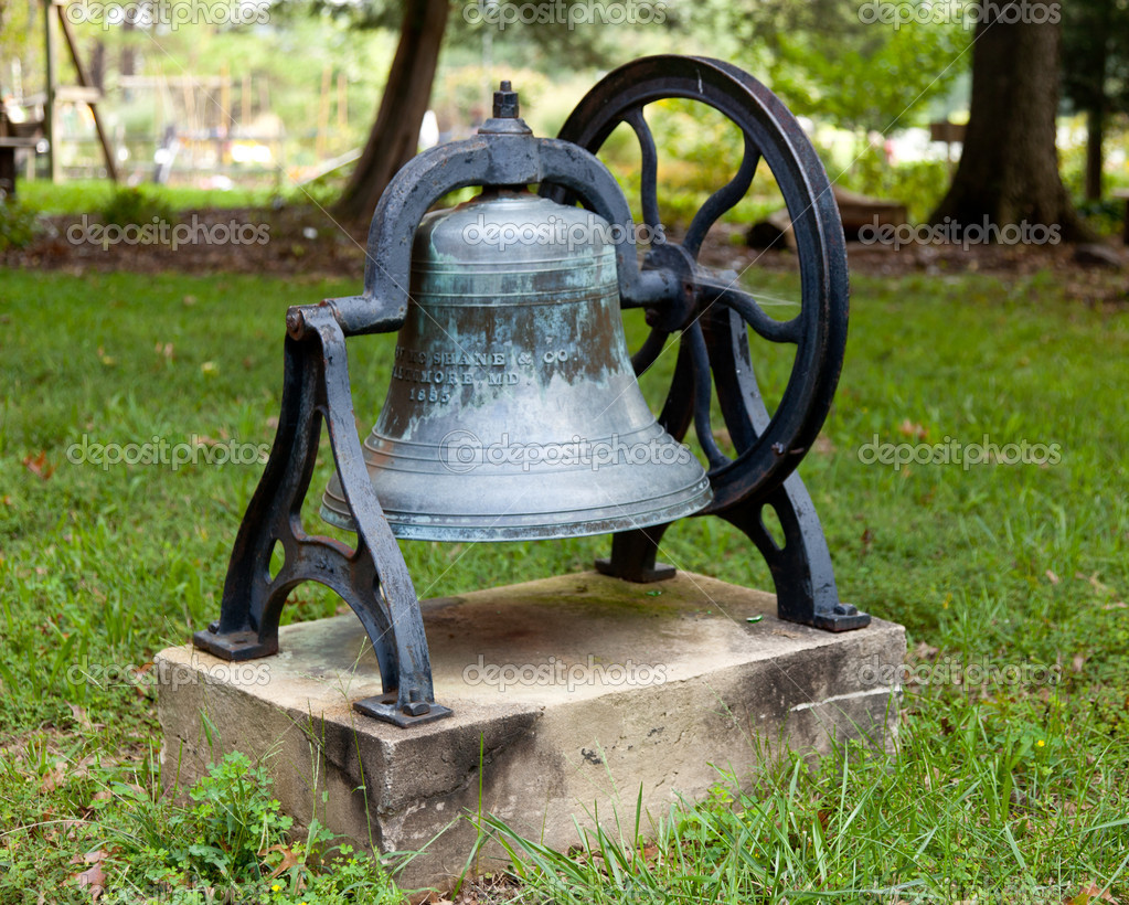 Old bell from church tower in frame in garden — Stock Photo #6765455