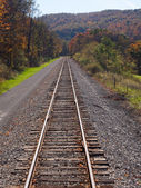 Railway tracks recede into distance — Stock Photo