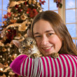 Bengal cat on girls arm — Stock Photo