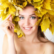 A girl with a wreath of autumn leaves on the head. — Stock Photo