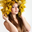 Stock Photo: A girl with a wreath of autumn leaves on the head.