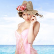 Young beautiful women in the pink pareos and hat near sea. — Stock Photo