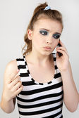 Closeup portrait of a cute young girl talking on mobile phone. — Stock Photo