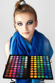 Stock Photo: Portrait of beautiful woman with makeup palette. — Stock Photo