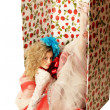 The doll in a gift box. — Stock Photo